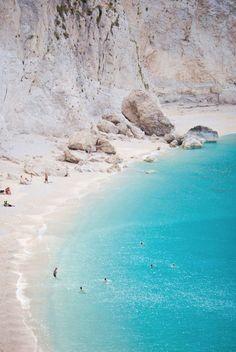 see the white sandy beach of porto katsiki, greece