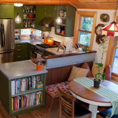 I like the cozy kitchen feel. Good separation idea- find a bar (maybe ikea kitchen cart or bookshelf) and create a breakfast nook on the other side...