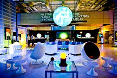 """The cocktail reception returned to the Weston Family Innovation Centre this year after taking over the Great Hall last year. Retro ball chairs, a circular lounge, and a hanging globe added to the """"Fly Me to the Moon"""" theme."""