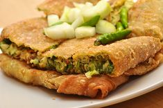 Savory Martabak Telor--Indonesian stuffed pancake. Can include garlic, onion, green onion, eggs, ground beef, and seasonings. Sweet variation is known as martabak manis, usually filled with chocolate or cheese.