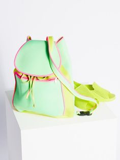 Head to the beach in style with this fab neon neoprene backpack.