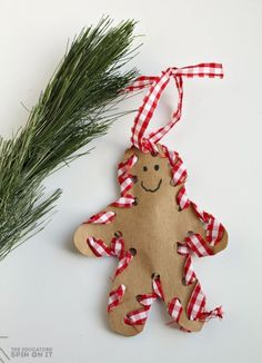Making a hand-sewn Gingerbread Man Ornament for Christmas to share with loved ones from your preschooler. Click now to see how to make.
