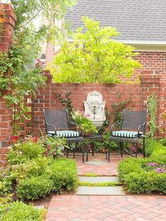 Even the smallest landscape will be improved by the mellow sound of trickling water. If you don't have enough space for a water garden, add a fountain or two in key locations in the yard. Be sure to have an electrical outlet nearby to plug in the fountain. In this slice of a brick courtyard, an ornamental wall-mounted fountain acts as a sparkling focal point. #gardenfountains