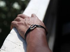 ($22.00) Feed 48 individuals. Every Global Tie sold will make a concrete change in the world. One bracelet/necklace with black leather and a gold pendant manufactured in environmentally friendly facilities.