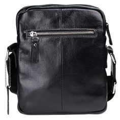 This beautifully crafted, quality leather messenger bag is versatile and functional. It is a great size for keeping your everyday essentials organized and right at your fingertips. It is worn across the body with an adjustable cloth strap.  This medium satchel is made from black genuine, shiny leather with silver metal styling details. It features two large cloth lined main zipper compartments including multiple card slots. It also features a smaller outer zipper pocket on the back of the…