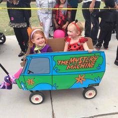 Daphne and her friend the lady bug in the Mystery Machine wagon. This kid loves Scooby Doo! Our friend at Element 7 printed the vinyl wrap for us and we mounted it on cardboard and attached it to the wagon.