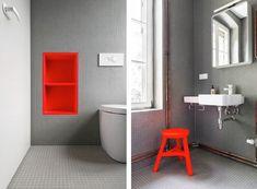 Gray tiled bathroom, neon red stool and shelf by Karhard, Berlin | Remodelista