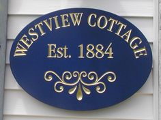 This classy cottage sign is entirely hand carved and gilded with gold - both text and accent. Cottage Names, Cottage Signs, Door Plaques, Name Plaques, Hamptons House, The Hamptons, Cabin Signs, House Signs, Property Signs