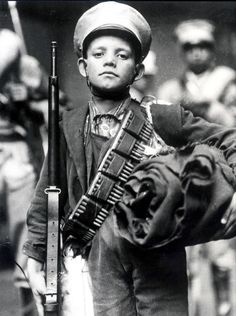 Niño Revolucionario. ca 1914. A visual argument for peace, negotiation, and compromise before war.