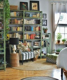 This handsome moss-colored shelving has us hankering to paint our own bookcases in an unconventional hue.