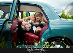 Wedding cars and transport by Greg Lumley photographer. Bride and Groom in aqua car with red seats.