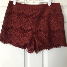 Forever 21 lace shorts Seldom-worn Forever 21 burgundy lace shorts. Fully lined with lace overlay. Zip/hook in back. Really cute alone or with tights. Only sign of wear is slight pilling on some of the bottom fringe (last picture). Offers welcome! Pet free, smoke free. Waist 15.5 in seam to seam, inseam 2 in. Forever 21 Shorts