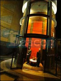 Beacon Elevator Co, capsule glass enclosed elevator. Used primarily in malls, and luxury high rise buildings