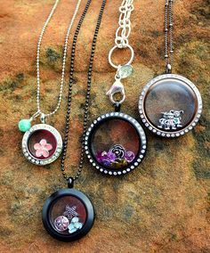 Large Black w/crystals, Large chocolate w/crystals, medium matte black, and silver mini with crystals. Visit my FB page Origami Owl By Jennifer Satterfield