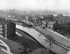 A view from Eccles, showing Bridgewater and Manchester Ship Canal with Trafford Park in the background.