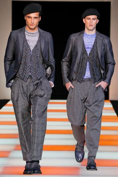 Giacca/maglioncino's runway show that exemplifies a modern day version of a zoot suit.