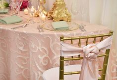 event or wedding decor - special touch: Add a rose knot sash to a chiavari chair. Here we show a gold chiavari with ivory cushion and blush matte satin sash tie. | Design by FestivitiesMN.com