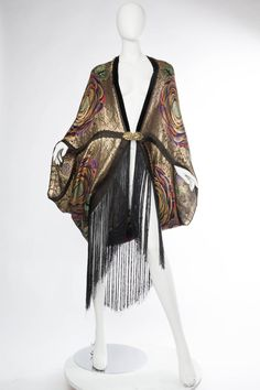 Phenomenal 1920s Lamé Cocoon Coat with Fringe   From a collection of rare vintage coats and outerwear at https://www.1stdibs.com/fashion/clothing/coats-outerwear/