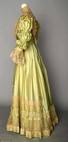 GREEN SILK TEA DRESS, c. 1898 2-piece mint green China silk, chemical lace flounce trim on bodice & skirt, silk chiffon waist, black velvet ribbon, white eyelet & diamante button trims. Sideway