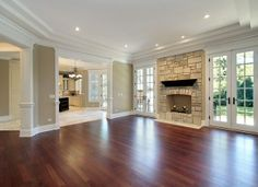 Love the moldings and French doors flanking the fireplace. Color of the walls is nice too!