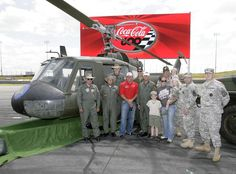 Ryan Newman poses with members of Military during an announcement for the Coca-Cola 600.