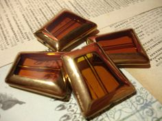 4 Amber Brown Gold Edged Trapezoid Glass Beads - $3 start bid at Tophatter.com Supplies with a Surprise LIVE auction, going on now! Come join the fun of real-time bidding on jewelry making and craft supplies.