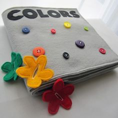 Now you can make the 8 page COLORS Fabric Quiet Book.    This 8 page book features a different design and flowers on each page to represent