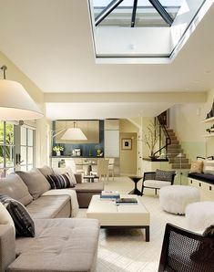 Sleek and stylish modern living space with central skylight    by Butler Armsden Architects