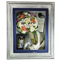 """This gorgeous keepsake is so unique! The preserved bouquet is displayed in a 16""""x20"""" Driftwood shadow box. The bride chose to display all of her mementos from her wedding, including her shoes."""