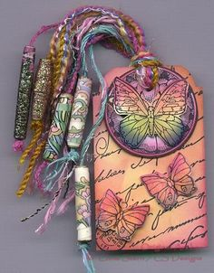 Rubber stamped Art Tag with hand made paper beads  Artist: Chris Stern  http://cs-designs.blogspot.com/2011/01/cs-designs-miscellaneous-gallery.html#