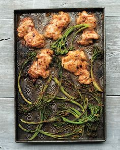 Spicy Peanut Chicken | Martha Stewart Living - Boneless chicken thighs and broccolini, both coated in a chili-spiked peanut sauce, emerge deliciously caramelized after just 10 minutes under the broiler.