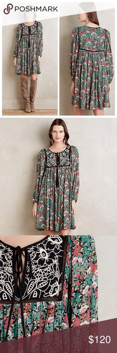 "Anthropologie floral dress size M NWT Anthropologie floral dress size M NWT. Floreat for Anthropologie. Peasant style dress. Black embroidered yoke. Tie front with tassels. Fully lined. Material: 100% viscose. Measurements: underarm to underarm 19"", length 39"". Anthropologie Dresses Mini"