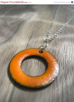 SALE The Positivity Circle Reversible Necklace Orange and Yellow Green Copper Enamel on a sterling silver chain Emanate Transform Surround. $33.15, via Etsy.