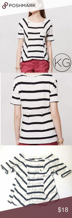 """Anthropologie Spliced Stripes Tee by Postmark In good pre-owned condition! Soft from light wear and washing but tons of life left👌🏼 •Women's size S •52% Linen, 48% Cotton •Black & white stripes with golden stitching on the inside •Button detail at the back provides more fitted silhouette, but I'd consider this t-shirt to be more slouchy & flowy bohemian style than the stock photo might convey  •Approx. 19"""" from underarm to underarm, 22"""" from shoulder to hem •Retail $48 🚫no trades nor…"""