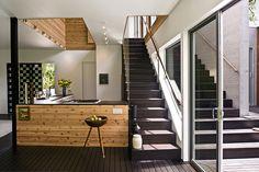 mirrored stairways interir/ Bates Masi Architects