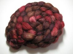 Cherry Cola - BFL/Tussah 85/15 - 5oz - from Corgi Hill Farm. This colour combination never fails to get my attention.