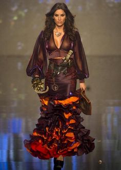 A model wears a creation by Spanish designer Rosalia Zahino during the International Flamenco Fashion Show in Seville, Spain on Saturday, February 2, 2013. (Photo by Miguel Angel Morenatti/AP Photo) http://avaxnews.net/fact/International_Flamenco_Fashion_Show_in_Seville.html #avaxnews.net #Fashion #wear