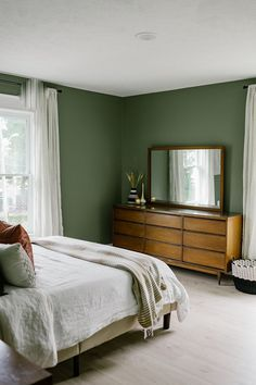 Our Sage Green Guest Bedroom with Midcentury Furniture - Miranda Schroeder sage green aesthetic, sage green paint color, sage green decor