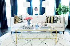 Living area with leopard and gold accents
