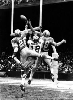 Lem Barney (20), Gene Washington (18) and Mike Weger (28) were all caught up in an aerial tangle of arms and legs during a play in 1970 between the Detroit Lions and the San Francisco 49ers. This photograph hangs in the National Football Hall of Fame at Canton, Ohio.  (The Detroit News)