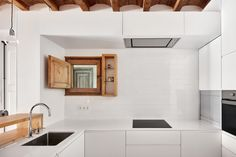 REFURBISHMENT OF A FLAT OF 27 MTSLONG IN THE EIXAMPLE OF BARCELONA by M2ARQUITECTURA as Architects Photographer: José Hevia Blach