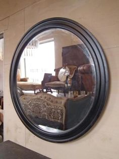 French House made circular ebonised mirror{br}diam.115cm (bespoke sizes/colours available){br}£750