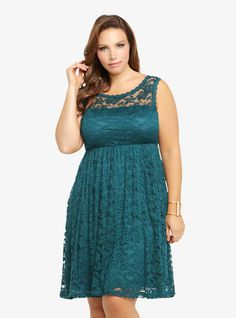 In a stunning allover lace look, this sleeveless deep teal dress has a smocked empire waist with a plunging V-back. Fully lined, the darling dress shows a flirty touch of skin on the top where the lace is see-through and accented with a matching lace picot trim on the scoop neck.