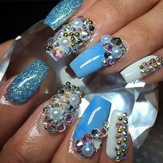 Blue, glitter, and crystal coffin nails