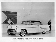 1954 Oldsmobile Super 88 Holiday Coupe Advertisement.