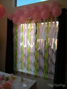 "streamer ""waterfall"" decor with balloons!  http://www.missmaesdays.com/baby-shower-on-a-budget/"