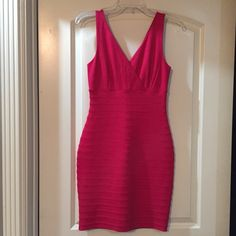 Express pink dress NWT Hot pink fitted, stretchy dress. Great dress. Super comfy. Only selling because I didn't go to the event I bought it for.  Looks way better on than on the hanger.  Bundle & Save! Express Dresses Midi