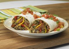 Andouille Burritos - These burritos are great for a crowd! Filled with rice, Andouille Sausage and Cheddar Cheese.