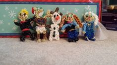 KRISTOFF, SVEN, OLAF, ANNA, and ELSA from Frozen. Loomed by Katie Schilp on the Rainbow Loom. (Rainbow Loom FB page). No tutorial.