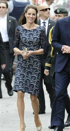Kate managed to incorporate her love of navy in this three-quarter-length lace dress that she accessorized with a nude clutch and pumps.